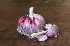A clove of organic garlic on a wooden table Royalty Free Stock Photos
