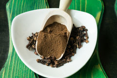 Clove pimento. Ground clove pimento spice in wooden scoop royalty free stock photos
