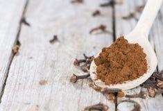 Clove Powder on a wooden spoon stock photos