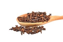 Clove spice in wooden spoon Stock Photos