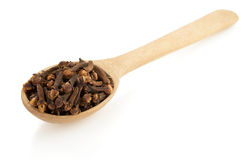 Clove spices and spoon  on white Stock Photo