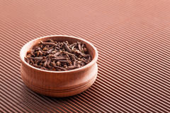 Clove in a wooden bowl close-up Royalty Free Stock Photography