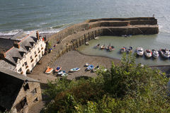 Clovelly - Devon - United Kingdom. The picturesque harbor at Clovelly on the North Devon coast in the United Kingdom stock photos