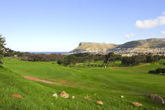 Clovelly golf course. The picturesque Clovelly golf course, nestled between mountains and with views of the town of Fish Hoek and the ocean Stock Photos