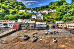 Clovelly harbour Devon England UK at low tide in HDR Stock Photo
