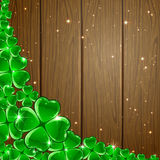 Clover background on wooden surface Stock Photo