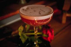 Clover club classy cocktail, with rose next to it stock photos