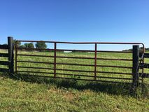 Clover farm gate. Farm gate into Kentucky clover field cattle pasture Stock Images