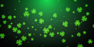 Clover flying leaves background. Saint Patrick`s Day banner. Three leaf clover leaves. Stock Photo