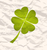 Clover with four leaves on crumpled paper Stock Photography