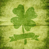 Clover with four leaves in grunge style vector illustration