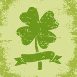 Clover with four leaves in grunge style Stock Photo