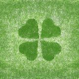 Clover with four leaves in grunge style Royalty Free Stock Photo