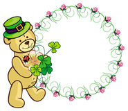 Clover frame and cute teddy bear in green hat.  Raster clip art. Stock Photo