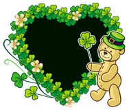 Clover frame and cute teddy bear in green hat.  Raster clip art. Stock Photography