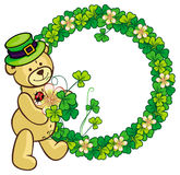 Clover frame and cute teddy bear in green hat.  Raster clip art. Stock Image
