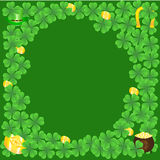 Clover Glade And Golden Coins Royalty Free Stock Photography