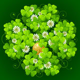 Clover and golden coin. Clover glade in the shape of quatrefoil Royalty Free Stock Photography