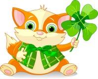 Clover kitten. Red kitten holding clover. St. Patrick's Day illustration Royalty Free Stock Image