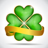 Clover leaf & gold ribbon Royalty Free Stock Photos