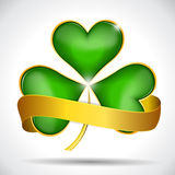 Clover leaf & gold ribbon Royalty Free Stock Photography