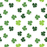 Clover leaf hand drawn doodle seamless pattern vector illustration. St Patricks Day symbol, Irish lucky shamrock background.  Royalty Free Stock Photos