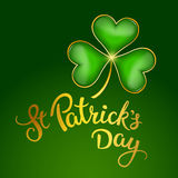 Clover leaf  and original handwritten text St Patrick's Day. Stock Image