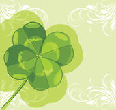 Clover leaf on the ornamental background stock photography