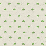 Clover leaf seamless pattern on paper texture Royalty Free Stock Photography