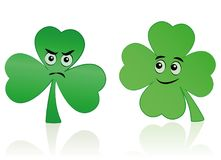 Clover Leaf Shamrock Comic Faces Happy Bad. Clover leaf and shamrock comic faces - happy smiling and angry figure Stock Photos