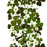 Clover leaves and flowers seamless tile Royalty Free Stock Image