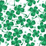 Clover leaves pattern design. Decorative seamless background with four leaves clover and flower for St. Patrick's Day Stock Photo