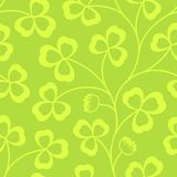 Clover leaves seamless vector pattern. St. Patrick`s Day green background. Shamrock wallpaper Stock Images