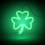 Clover neon lamp. Green neon sign, Shamrock Clover on dark background. Design element for St Patrick`s Day. Ready for your design, greeting card, banner. Vector royalty free illustration