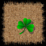 Clover on organic weave Royalty Free Stock Image