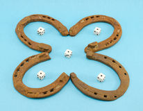 Clover retro horse shoes gamble dice on blue Stock Photography