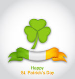 Clover with ribbon in traditional Irish flag colors Stock Image