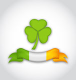 Clover with ribbon in traditional Irish flag colors for St. Patr Stock Photo