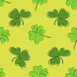 Clover seamless pattern. Clover pattern with three and four leaf. Green on yellow background. St. Patrick`s Day hand-drawn doodle style clover endless repeat Stock Photography