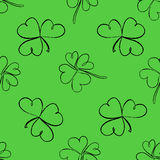 Clover seamless pattern. Clover pattern with three and four leaf. St. Patrick`s Day hand-drawn doodle style clover endless repeat backdrop, texture, wallpaper Stock Image