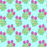 Clover seamless pattern. Pink clover flower with green leaves on a blue background with white polka dot seamless pattern Stock Photo
