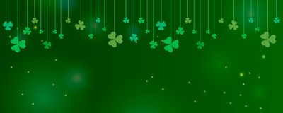 Clover shamrock leaves hung on strings on dark green background. Abstract St. Patrick`s day border horizontal panorama background. With place for your text for stock illustration