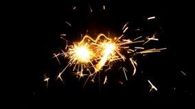 Clover shaped sparkler. Luck symbol - clover shaped sparkler on black background stock video