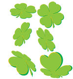 Clover shapes. Six four-leaved clover shapes on white Stock Photos
