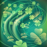 The clover tales. Illustration with clover leaves against green wavy background drawn in fairy tale style Stock Photo