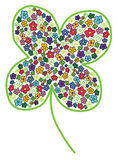 Cloverleaf with colored flower Stock Photography