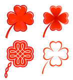 Clovers and hearts. Four-leaf-clovers consist of four red hearts. And there are four different variants Royalty Free Stock Image