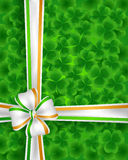 Clovers and ribbon Stock Image
