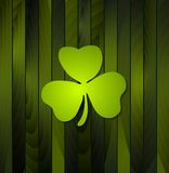 Clovers shamrock on green wooden background Royalty Free Stock Image
