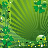 Clovers for St. Patrick's Day. Abstract colorful background with four leaf clovers, butterflies, small circles, green bubbles for St. Patrick's Day Royalty Free Stock Photo
